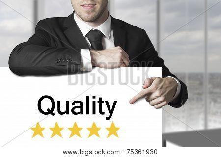 Businessman Pointing On Sign Quality