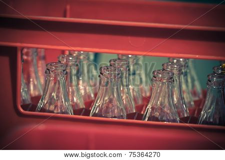 Red Plastic Crate With Empty Glass Bottles