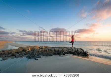 Island beach sunrise and yoga practice