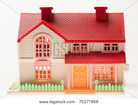 Dollhouse close up on a light background