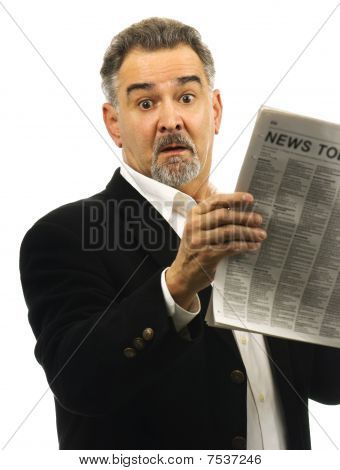 Man Looks Shocked While Reading Newspaper