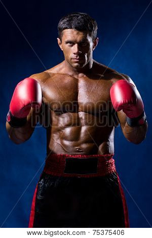 Boxer Boxing Staring Showing Strength. Young Man Looking Aggressive With Boxing Gloves.