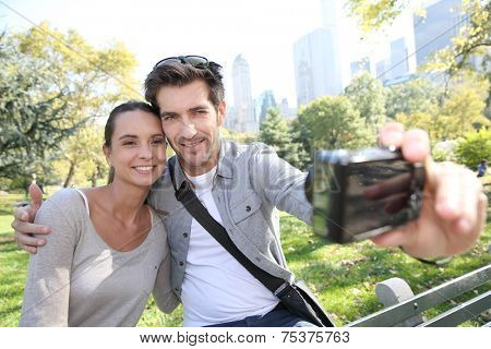 Couple in Central Park taking picture of themselves