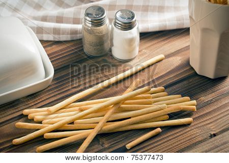 breadsticks grissini on wooden table