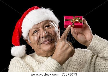 Male Senior With Red Pompom Hat And Christmas Gift