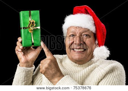 Gleeful Aged Man Pointing At Raised Green Present