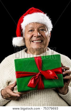 Male Senior With Santa Claus Cap And Green Gift
