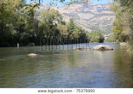 Fly fisherman fishing in spanish river