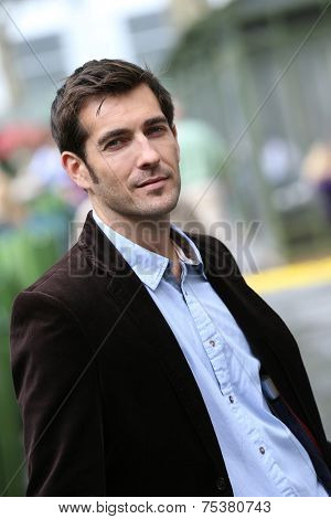 Businessman standing in city steet