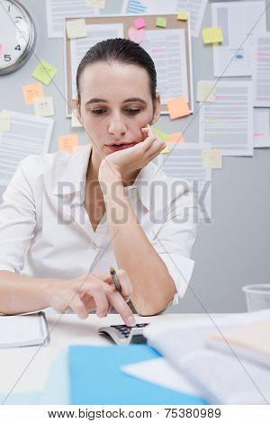Office Clerk Using Calculator