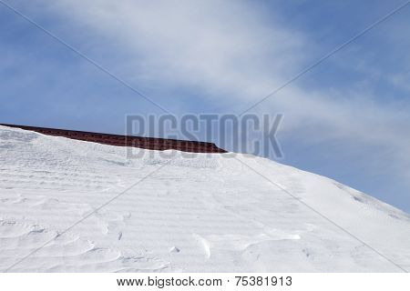 Roof In Snow And Blue Sky