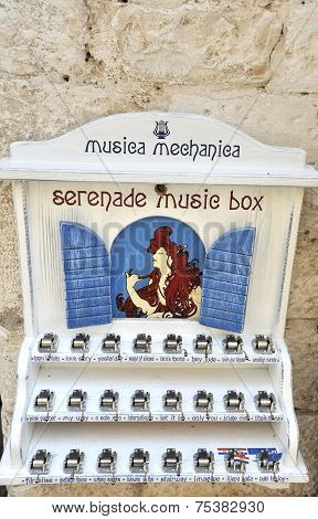 Music boxes on a stand