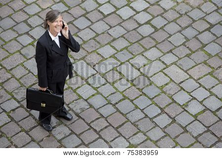Bird's-eye View Of A Businesswoman In The Street On The Phone