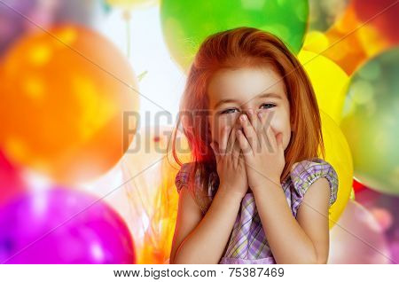 little girl and color balloons