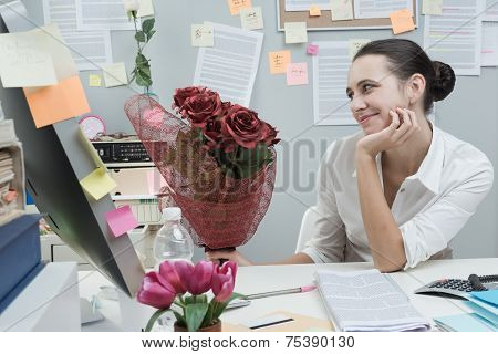Woman Receiving A Romantic Surprise At Work.