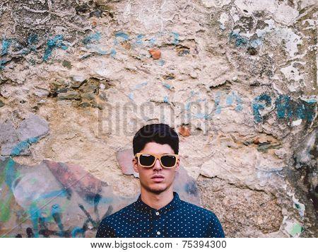 Fashionable Man Portrait Over Ruinous Wall Background