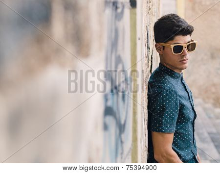 Fashionable Man Portrait Over Ruinous Wall