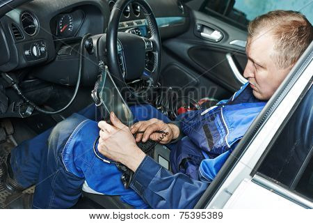 automobile computer diagnosis auto repairman industry mechanic worker servicing car auto in repair or maintenance shop service station
