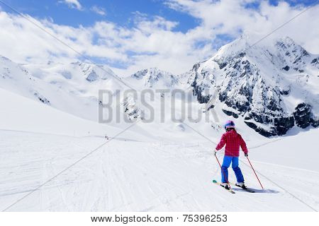 Skiing, winter sport, ski lesson - skier on mountainside