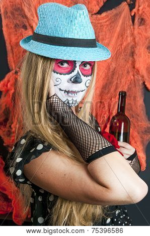 Girl with Calavera Mexicana makeup mask in the hat