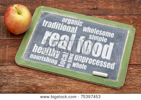 real food word cloud on a blackboard with an apple - healthy lifestyle concept