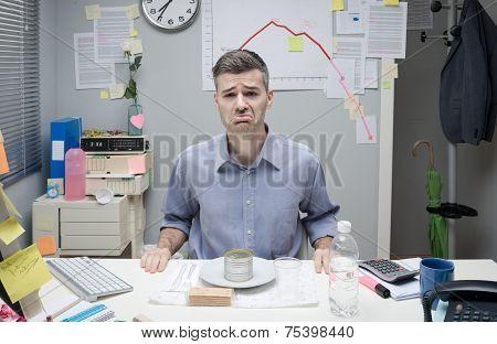 Businessman Having A Sad Lunch