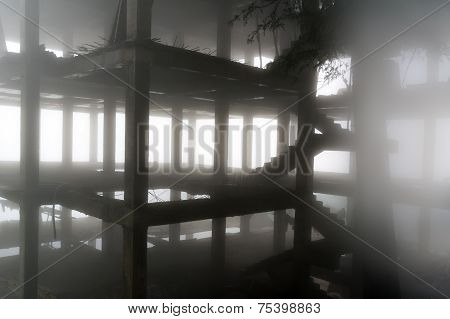 Building Under Construction In Fog