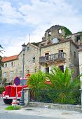 pic of fire-station  - The fire station of Perast with the red fire truck parked in front of it Perast Montenegro - JPG