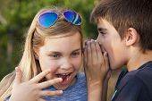 foto of pimp  - boy and girl counting a secret to the ear - JPG