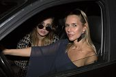 pic of starlet  - two women with sunglasses sitting in a car - JPG