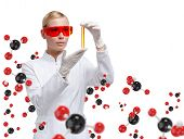 stock photo of combinations  - Young woman doctor in glasses hands vial on chemical combination background - JPG