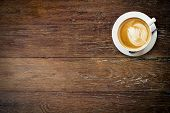 foto of latte  - latte coffee on wood with space for text - JPG