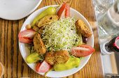 stock photo of alfalfa  - A beansprout salad with alfalfa bean sprouts tomato croutons pepper chick peas mayonaise and green vegetables shot from the top. A healthy vegetarian food diet. ** Note: Shallow depth of field - JPG