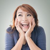 stock photo of excite  - Excited happy Asian girl face - JPG