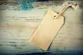 foto of canvas  - Canvas empty price tag with old wooden background - JPG