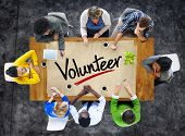 picture of word charity  - People in a Meeting and Single Word Volunteer - JPG