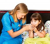 stock photo of cough syrup  - Beautiful little girl gladly taking her syrup for her cough - JPG