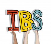 stock photo of colitis  - Group of Hands Holding IBS Letter - JPG