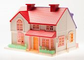 stock photo of premises  - Dollhouse close up on a light background - JPG