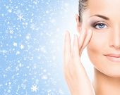 foto of winter  - Spa portrait of young and beautiful woman over winter Christmas background  - JPG
