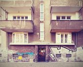 picture of neglect  - Vintage filtered picture of neglected tenement house - JPG