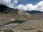 stock photo of mustang  - A riverside town near Upper Mustang in an oasis in the furthermore desert - JPG