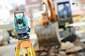 foto of geodesic  - Surveyor equipment tacheometer or theodolite outdoors at construction site - JPG