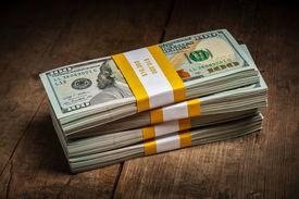 stock photo of 100 dollars dollar bill american paper money cash stack  - Creative business finance making money concept  - JPG