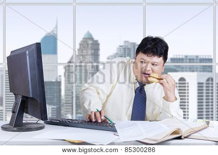 Scared Businessman Looking At Monitor