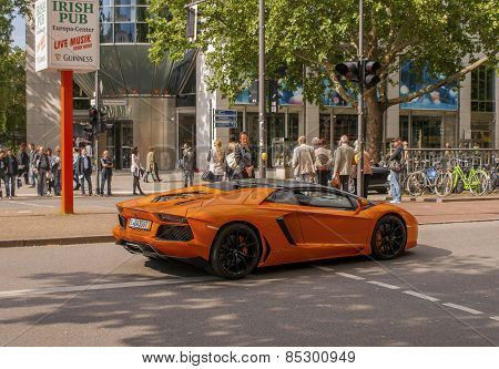 Orange Supercar Lamborghini At The City Street In Berlin