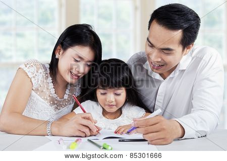 Young Family Doing Schoolwork Together