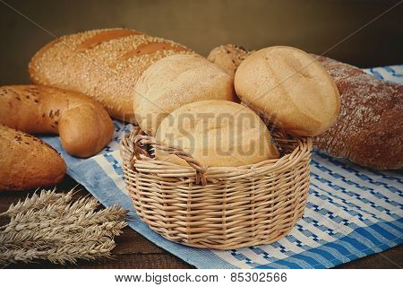 Wicker basket with bread products on the tablecloth