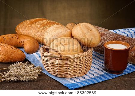 Bread products with milk cup on the tablecloth