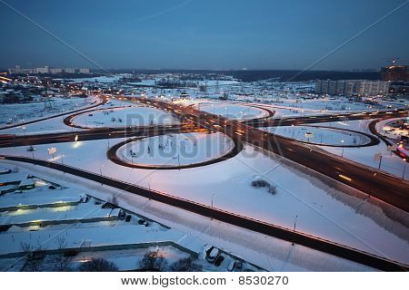 Evening Winter Cityscape With Big Interchange, Lighting Columns